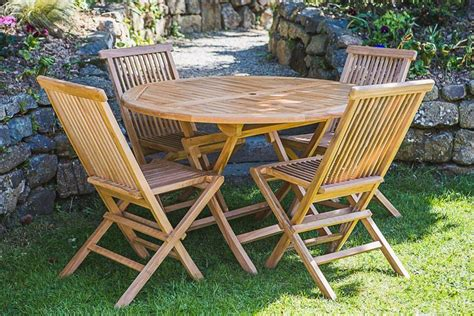 Garden Patio Table And Chairs by Teak Garden Table And Chair Set Garden Furniture Land