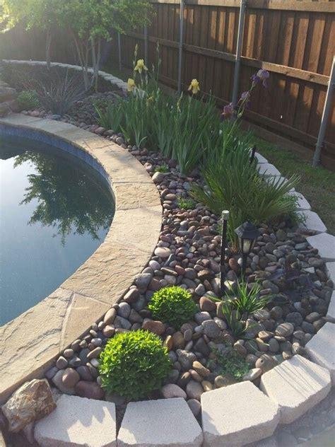 pool landscaping with rocks rock garden flower bed behind pool backyard oasis pinterest rock gardens and flower