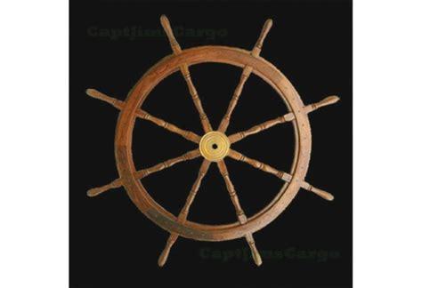 classic wooden ship wheel  brass cap nautical home