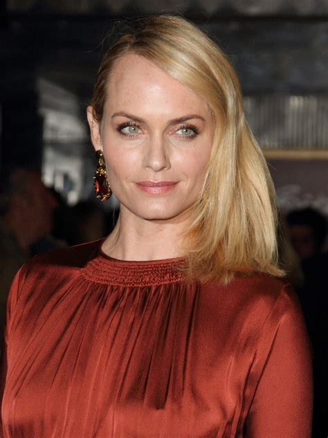 amber valletta wearing  long hair styled   side