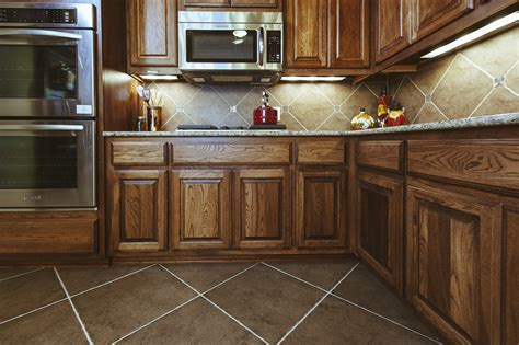 tile flooring ideas for kitchen brown kite shape tile floor combined with brown wooden