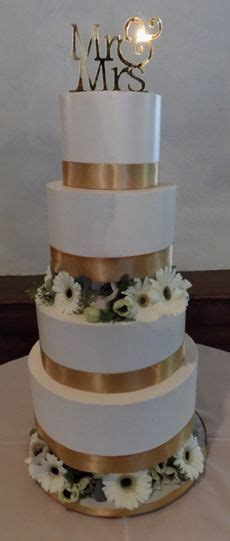 gold ribbon for wedding cake 4 tier buttercream seperator wedding cake decorated with 14806