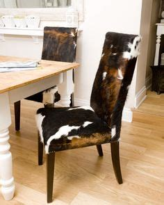 Cowhide Dining Chairs Uk - 1000 images about cowhide upholstered furniture on