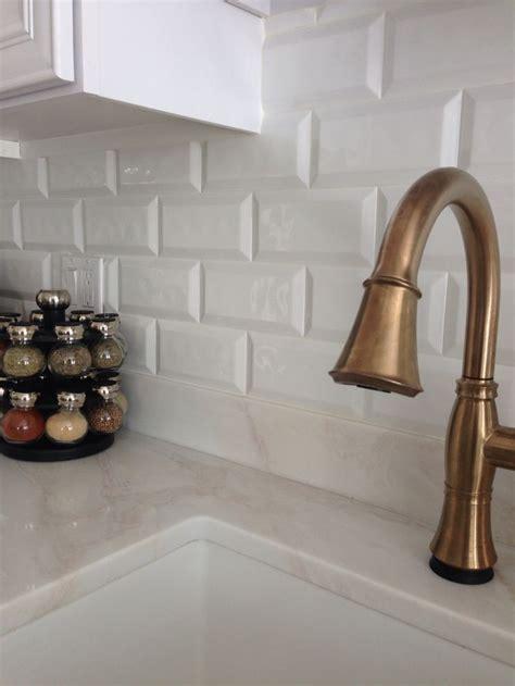 champagne bronze delta cassidy faucet cobsa white bevel tile backsplash kitchen pinterest