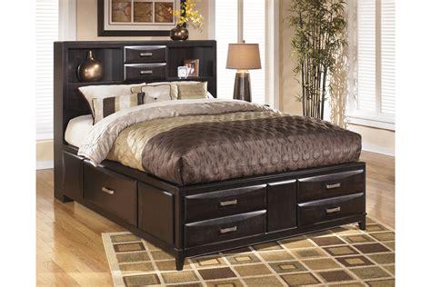kira queen storage bed  ashley furniture rileys