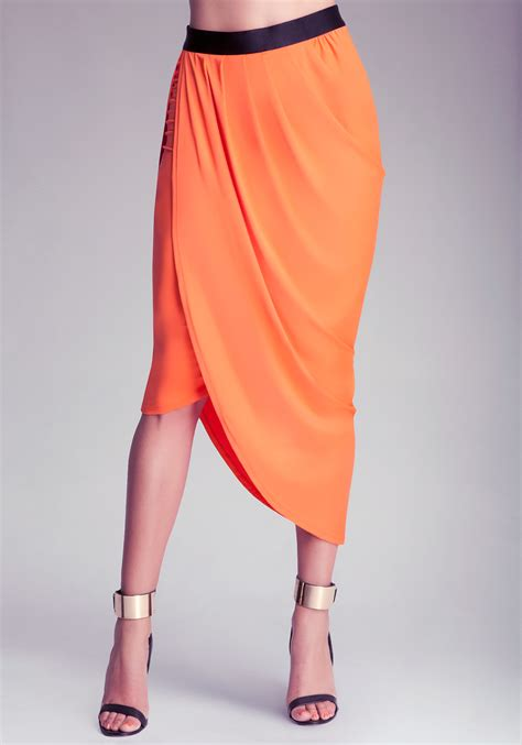 draped in bebe side draped skirt in orange lyst