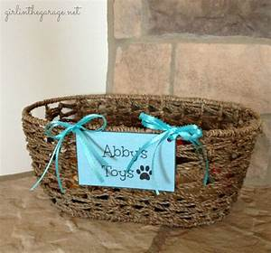 basket for dog toys girl in the garager With dog toy basket