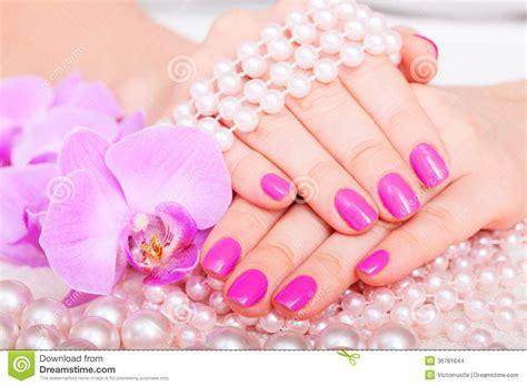 Beautiful Manicure And Pedicure In Spa Salon. Stock Photo