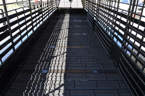 """Rubber flooring is durable, which is a big plus for trailer flooring. 2016 Neckover 6'8""""x32' Triple Axle Stock Trailer w ..."""