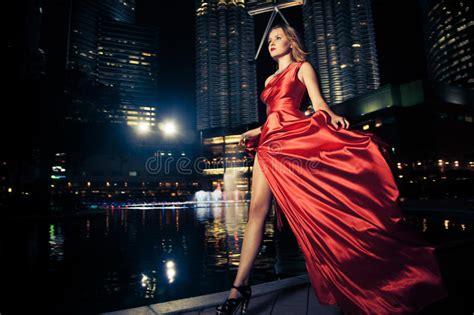 fashion lady  red dress  city lights stock photo