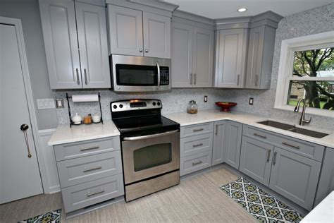 Savvy Gray Cabinet Kitchen Remodel with Island Seating