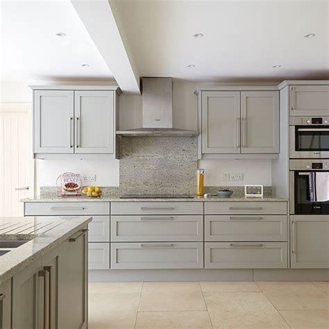 Grey kitchen with stone flooring   Decorating