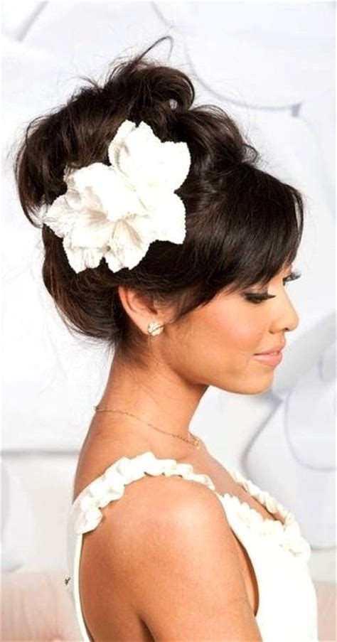 High Looped Updo With Bangs And Flower Wedding Hair