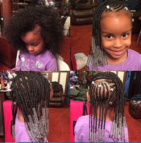 gorgeous braided style done by amber belovely black hair