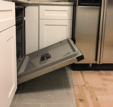 dishwasher door hits refrigerator  open
