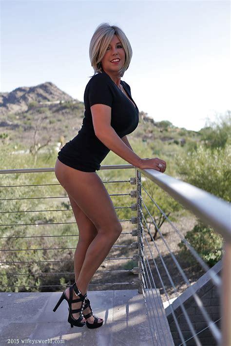 Buxom older housewife Sandra Otterson flashing thong covered ass outdoors - PornPics.com
