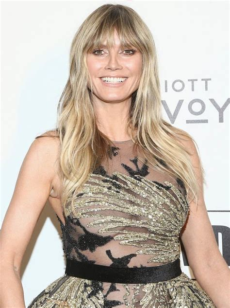Heidi Klum Puts Leggy Display Gold Sheer Dress