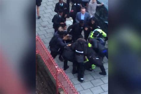 shocking moment mob   schoolchildren attack  police