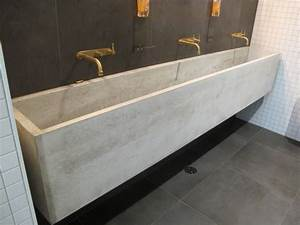 long gray concrete sink with triple faucet on the black With concrete bathroom sinks for sale
