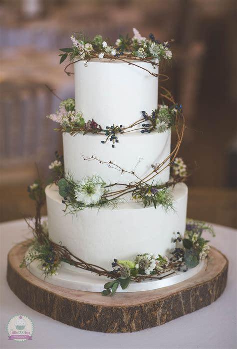 tier rustic buttercream wedding cake  fresh flowers