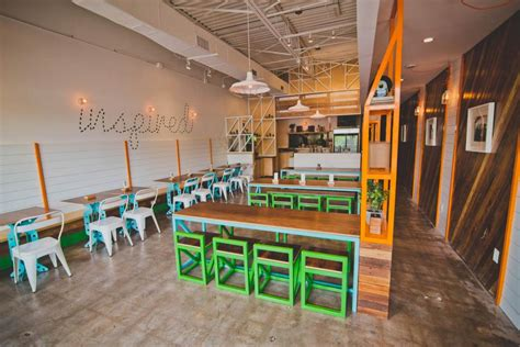Colorful Industrial Restaurant With Custom Furniture
