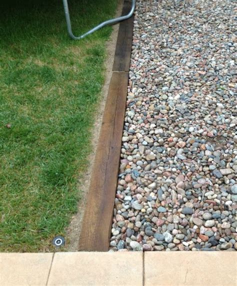 gravel driveway border railroad ties for driveway edging all we have left to do is put the rock back and new bark