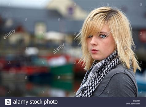 Blonde 18 Year Old Girl Looking Over Shoulder Eye Contact