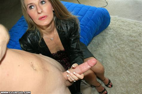 Lascivious Long Haired Mature Lady Showing Off Her Handjob Skills