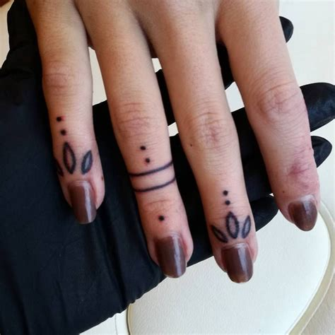 bold  unusual finger summer tattoo ideas