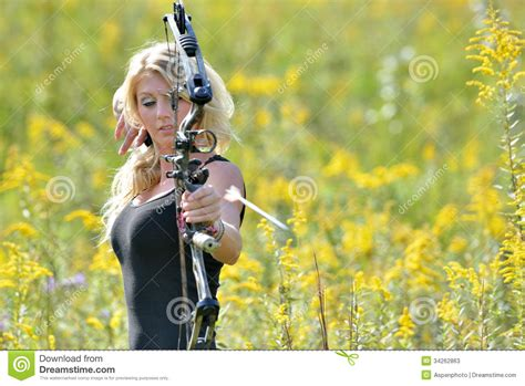 best archery beautiful archer shoots an arrow stock photos