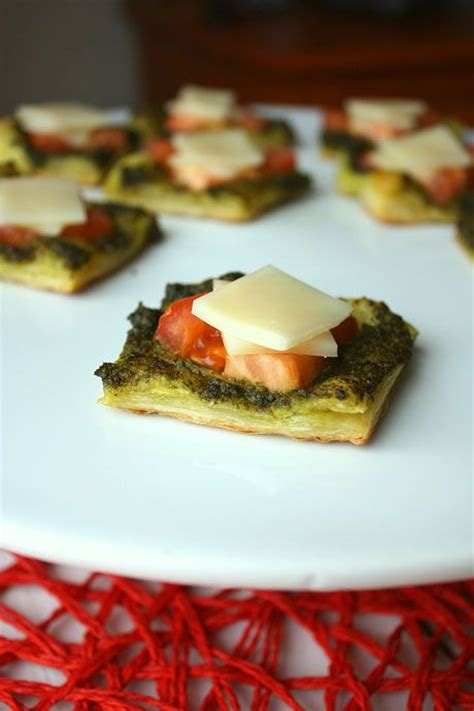 puff pastry canapes ideas pesto puffs appetizer puff pastry pesto tomatoes and mozzarella canapes starters
