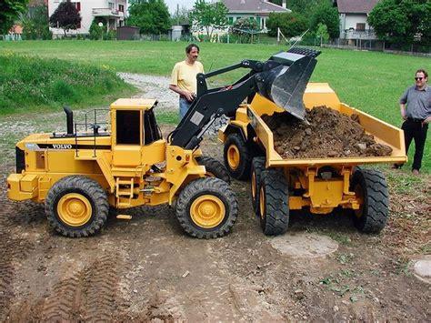 worlds largest  scale rc dump truck loader excavator bring  trailer cars