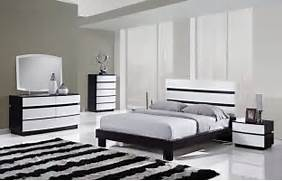 Find Out The Most Recent Images Of Black White Bedroom Furniture Here Black White Bedroom Interior Design Ideas Chic Cheerful Bedroom Decor Done In Black And White Cappuccino Wood Black And White Bedrooms Sophisticated Black And White Bedroom