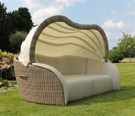 rattan outdoor garden lounge or large daybed in light