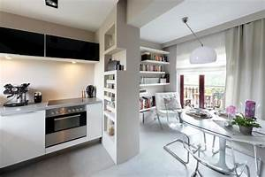Open kitchen with transparent cantilever chairs at the