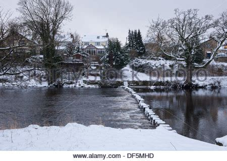 stepping stones the river wharfe to drebley on the 244 | cold winter scene with snow covered riverside houses stepping stones df5mhd