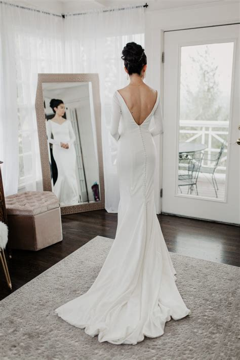 minimalist wedding dress  long sleeves  train