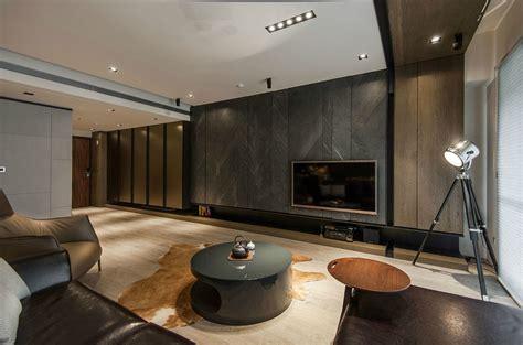 Stone And Wood Make A Dark, Masculine Interior