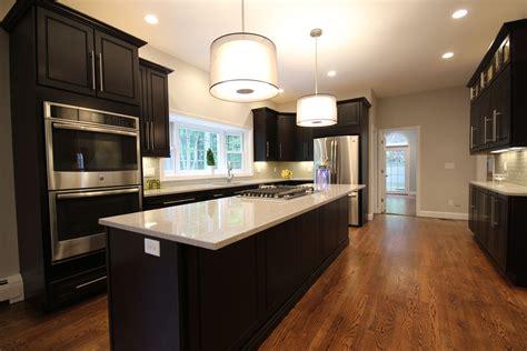 kitchen wood backsplash kitchen with wood floor cabinets light countertops 3502
