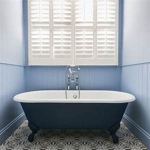 Traditional Bathroom With Blue Roll Top Bath And Shuttered