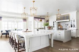 two kitchen islands unified with brass lanterns With best brand of paint for kitchen cabinets with hollywood sign wall art