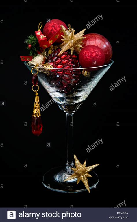red and gold christmas decorations in cocktail glass