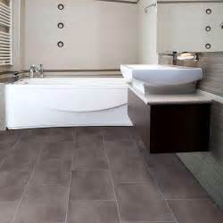 bathrooms flooring ideas big grey tiles flooring for small bathroom with awesome white bathtub and astounding