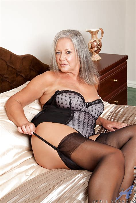 fatty granny in stockings taking off her lingerie and