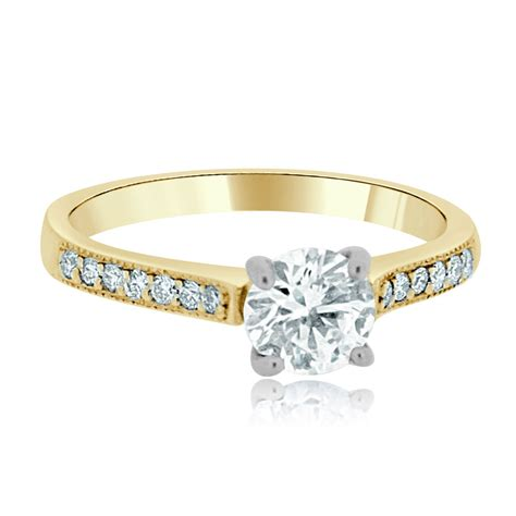 18ct yellow gold 0 6ct round brilliant cut diamond with