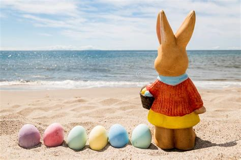 beach easter background  bunny  color eggs stock