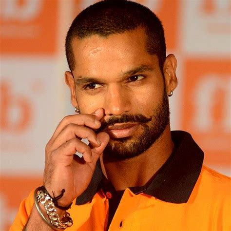 shikhar dhawan hair style shikhar dhawan twirls his moustache and his bat in style