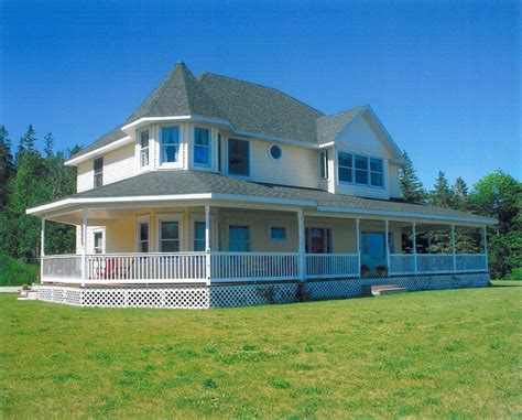 Two Story House With Wrap Around Porch by 20 Homes With Beautiful Wrap Around Porches Housely