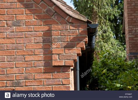 Corbelling On Corner Of Red Brick House On Exclusive