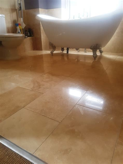 restoring the appearance of travertine floor tiles in